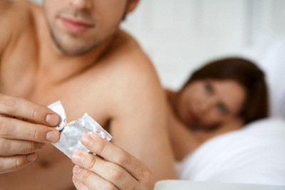 Couple Practicing Safe Sex --- Image by © moodboard/Corbis